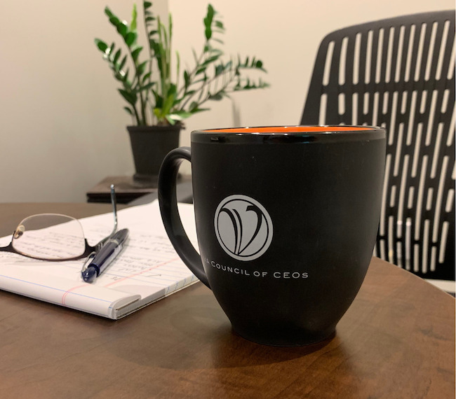 Coffee cup with VACEOs logo
